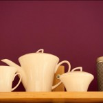 teapot and cups on a shelf_b