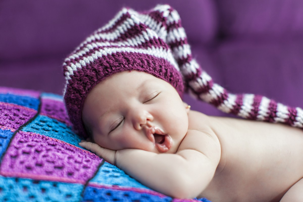 baby in a knitted stripped hat